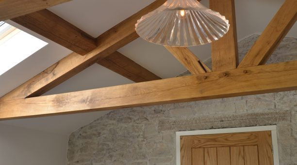 Parker SW Ltd - Oak beams and door in modern extension to stone property